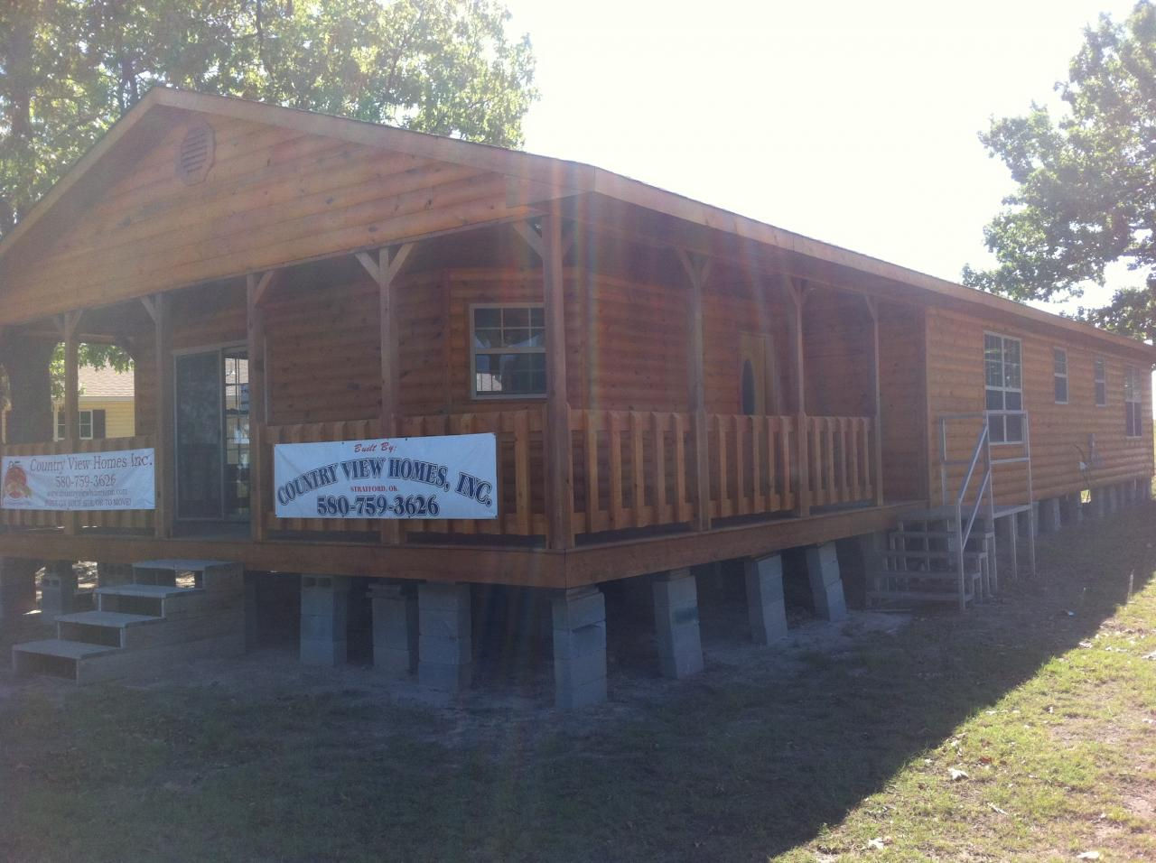 1500 sq ft log home with wrap around porch joy studio for Cost to build a 1500 sq ft home